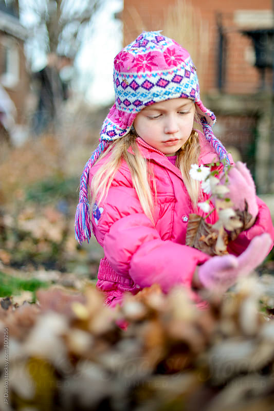 Little Girl Playing In Fall Leaves in Autumn by JP Danko for Stocksy United