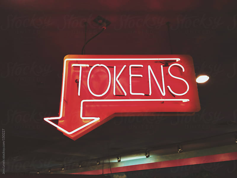 neon token sign by Jess Lewis for Stocksy United