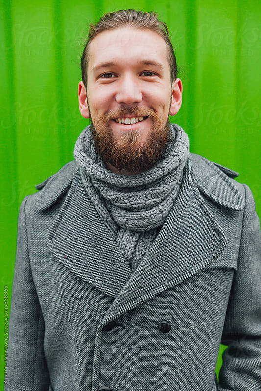 Man in front of the green background by Dimitrije Tanaskovic for Stocksy United