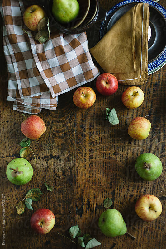 Apples and pears on a wood table,seen from overhead, ready to be prepared for a recipe. by Darren Muir for Stocksy United