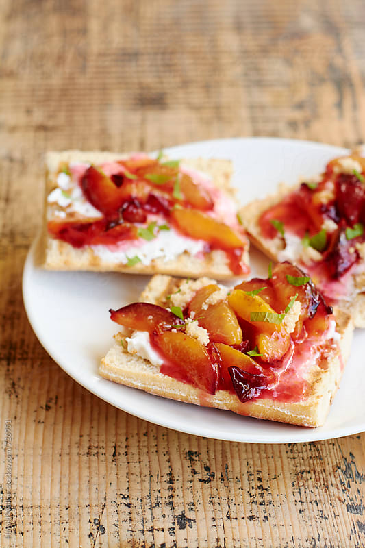Bruschetta with Vegan Cream Cheese and Plums by Harald Walker for Stocksy United