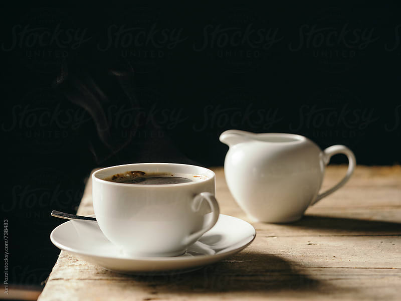 steamy cup of coffee by Juri Pozzi for Stocksy United
