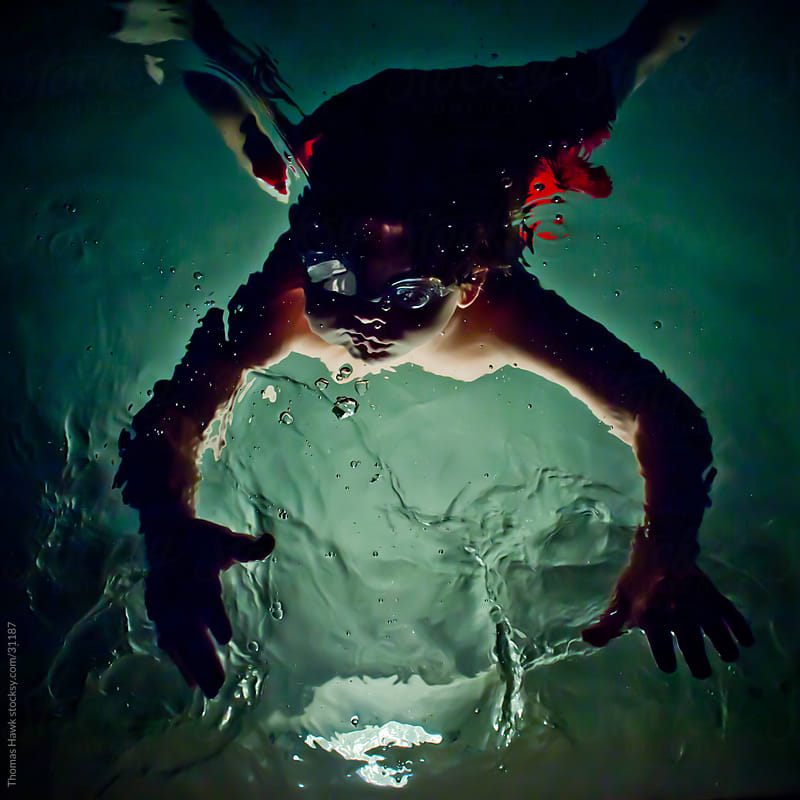 Kid Night Swimming by Thomas Hawk for Stocksy United