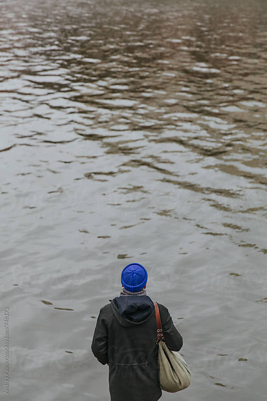 Man standing alone in front of water by Andrey Pavlov for Stocksy United