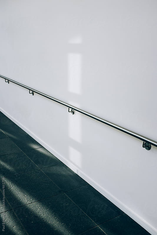 Handrail and walkway in modern building by Paul Edmondson for Stocksy United