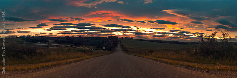 Country road sunset in the foothills by Christopher Troy Dowsett for Stocksy United