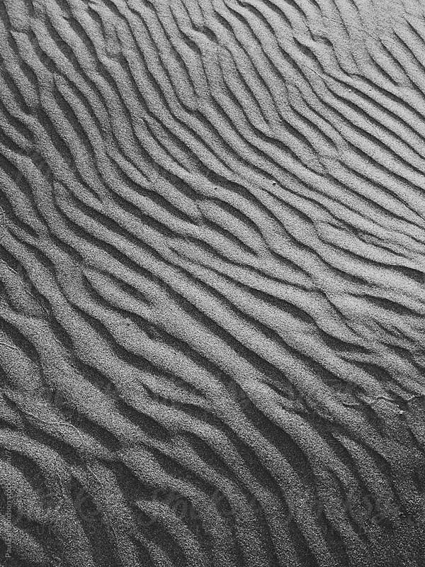 Patterns on beach sand at dusk, close up by Paul Edmondson for Stocksy United