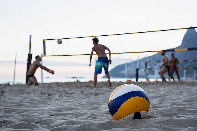 People playing Volleyball on Ipanema beach, Rio de Janeiro, Brazil. by Mauro Grigollo for Stocksy United