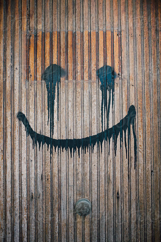 smile graffiti by Thais Ramos Varela for Stocksy United