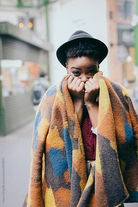 Black woman outdoors during a cold day by Mauro Grigollo for Stocksy United