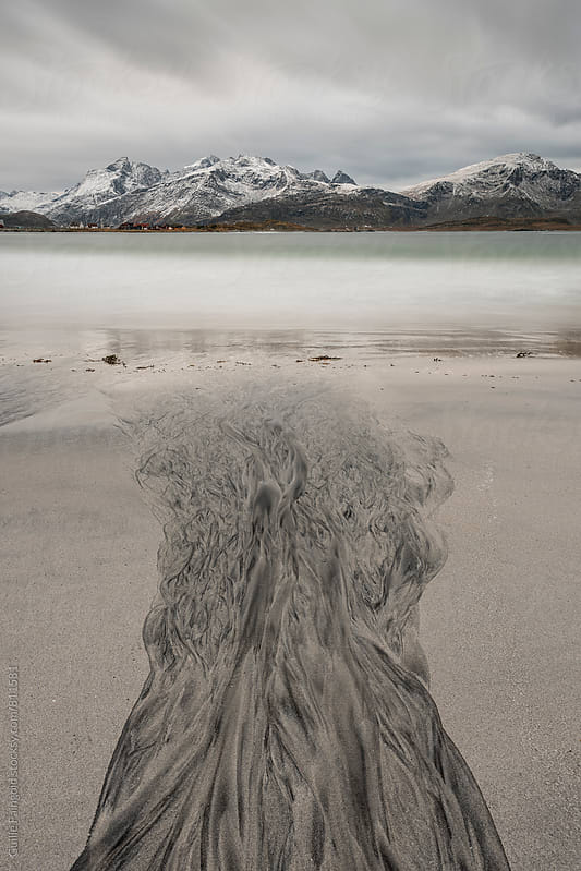 Abstract textures in the sand at Ramberg beach, Norway by Guille Faingold for Stocksy United