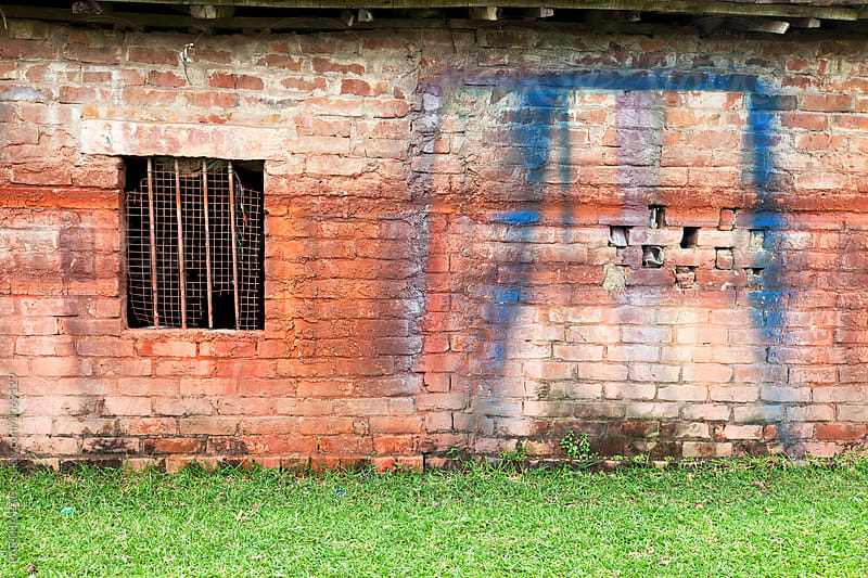 Spray painting on the wall with window by PARTHA PAL for Stocksy United