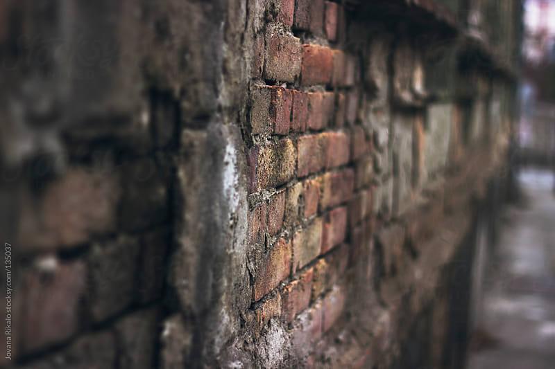 Old brick wall by Jovana Rikalo for Stocksy United