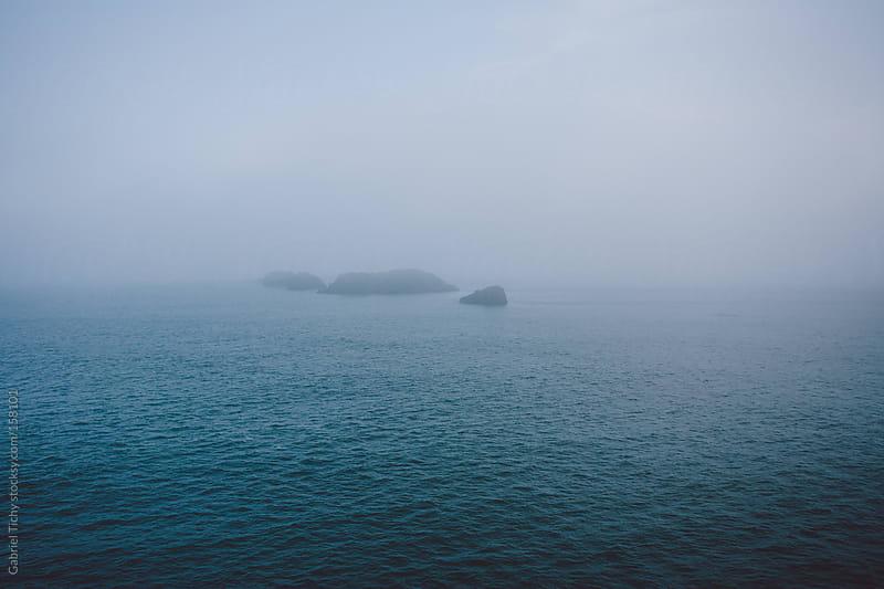 Foggy ocean view by Gabriel Tichy for Stocksy United