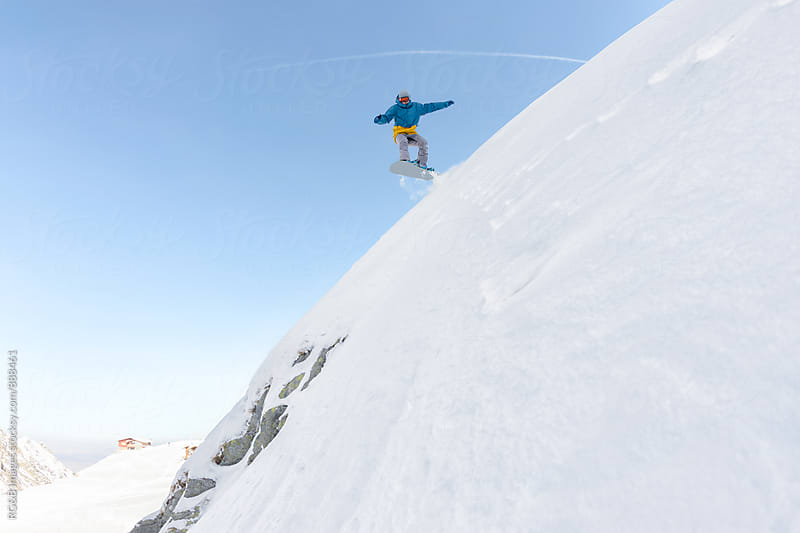 Snowboarder jumping on the slope  by RG&B Images for Stocksy United