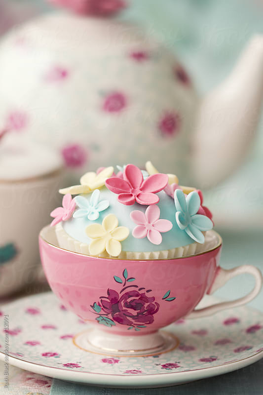 Flower cupcake in a vintage teacup by Ruth Black for Stocksy United