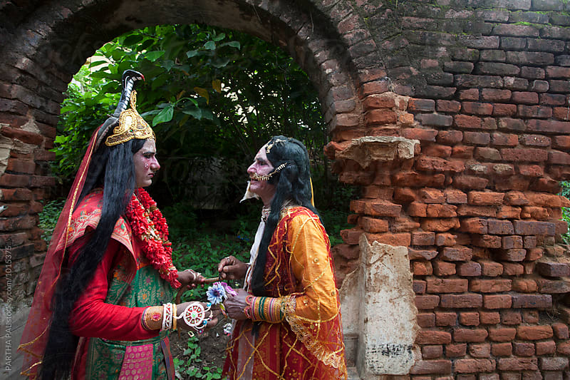 Father and son decorating themselves as Hindu God and Goddess and Holding Hands. by PARTHA PAL for Stocksy United