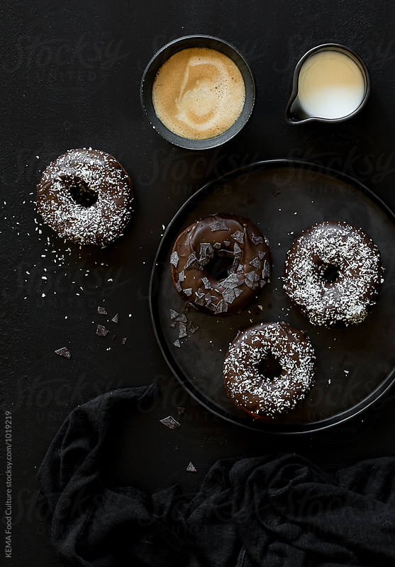 Homemade baked chocolate donuts with coffee for breakfast by KEMA Food Culture for Stocksy United