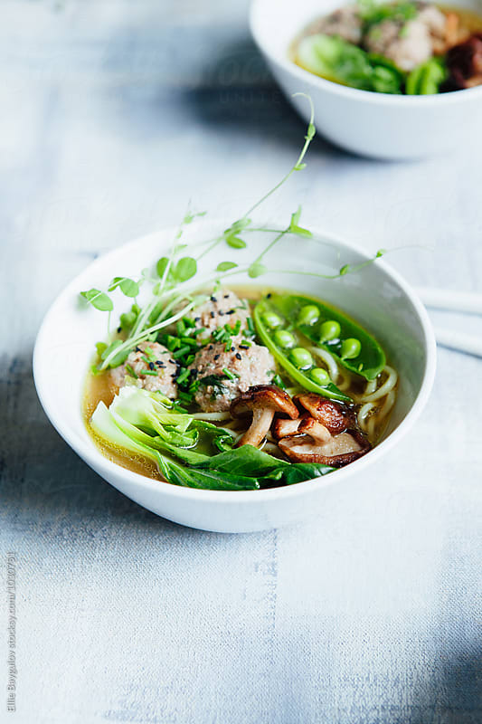 Meatball soup in miso broth by Ellie Baygulov for Stocksy United