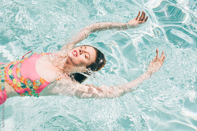Girl swimming in the pool by Puno Puno for Stocksy United