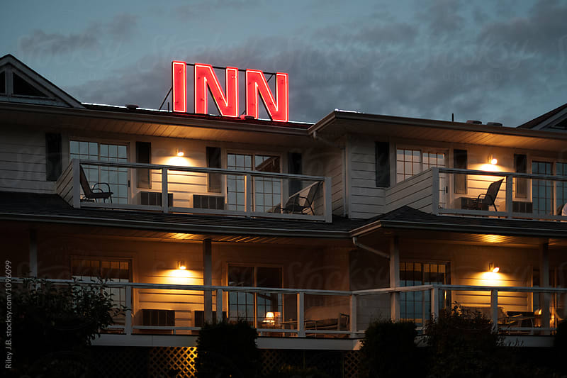 Neon sign on top of Inn at dusk. by Riley J.B. for Stocksy United