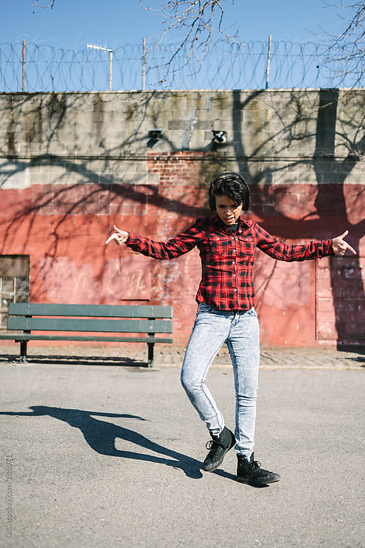Young woman during krump break dance in Williamsburg, Brooklyn by GIC for Stocksy United