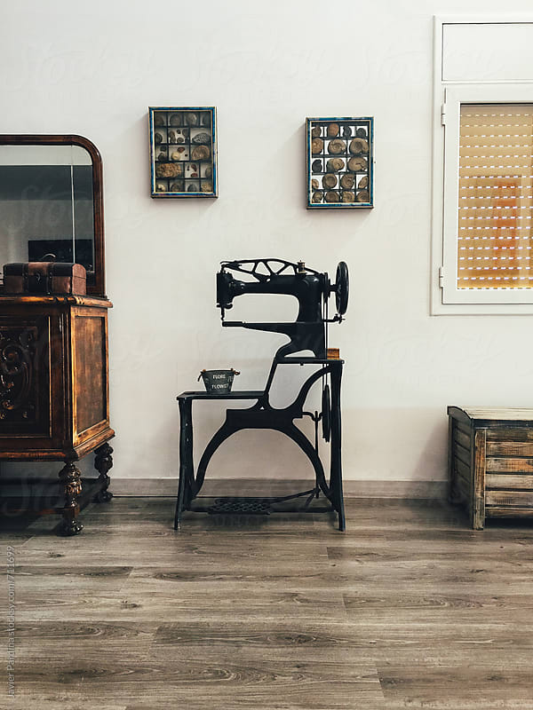 detail of a old sewing machine by Javier Pardina for Stocksy United