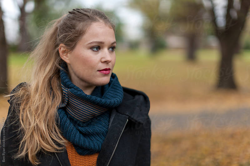 Stylish young woman in an autumn park by Ben Ryan for Stocksy United