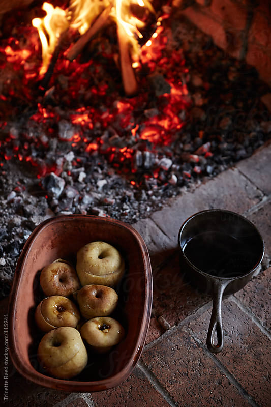 Baked apples in ceramic bowl cooked over the fire by Trinette Reed for Stocksy United