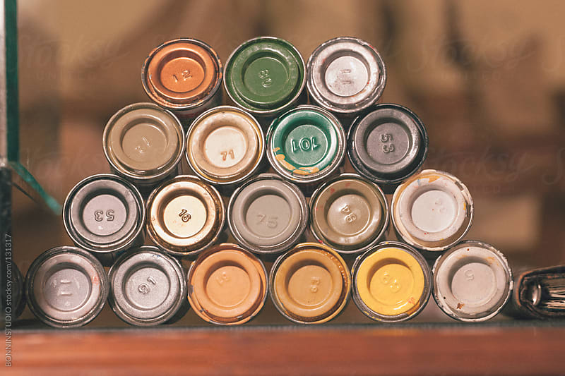 Various small tins of paint. by BONNINSTUDIO for Stocksy United