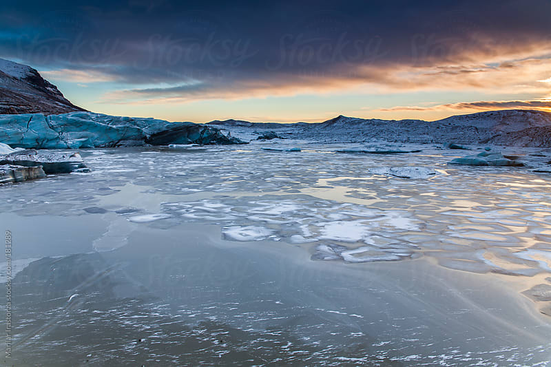 Sunset on the glacier  by Marilar Irastorza for Stocksy United