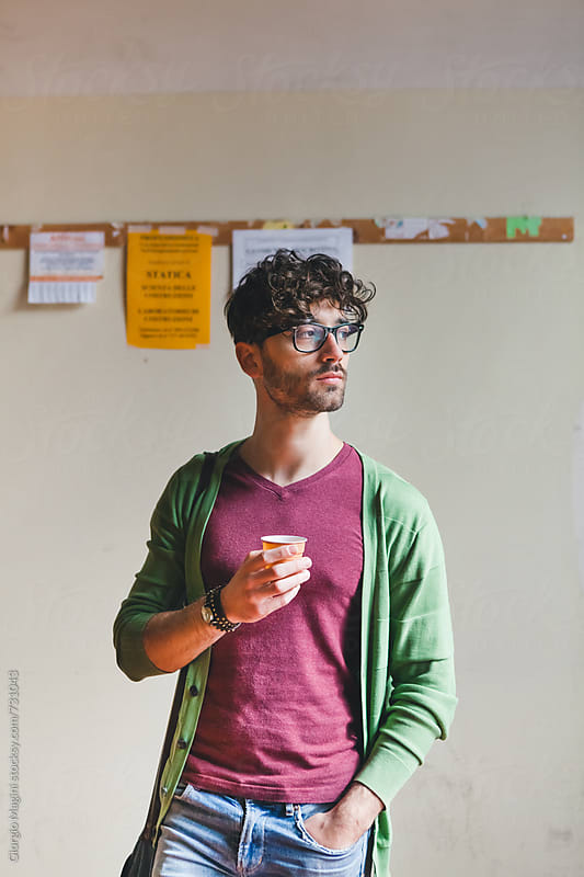 College Student Having an Espresso Coffee at the Campus by Giorgio Magini for Stocksy United