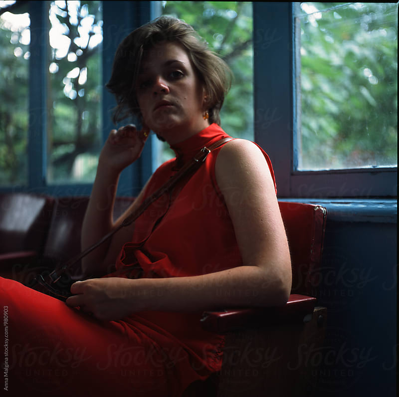 The film portrait of a young woman in red dress by Anna Malgina for Stocksy United