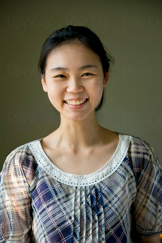 Lovely young woman with happy smile  by Lawren Lu for Stocksy United