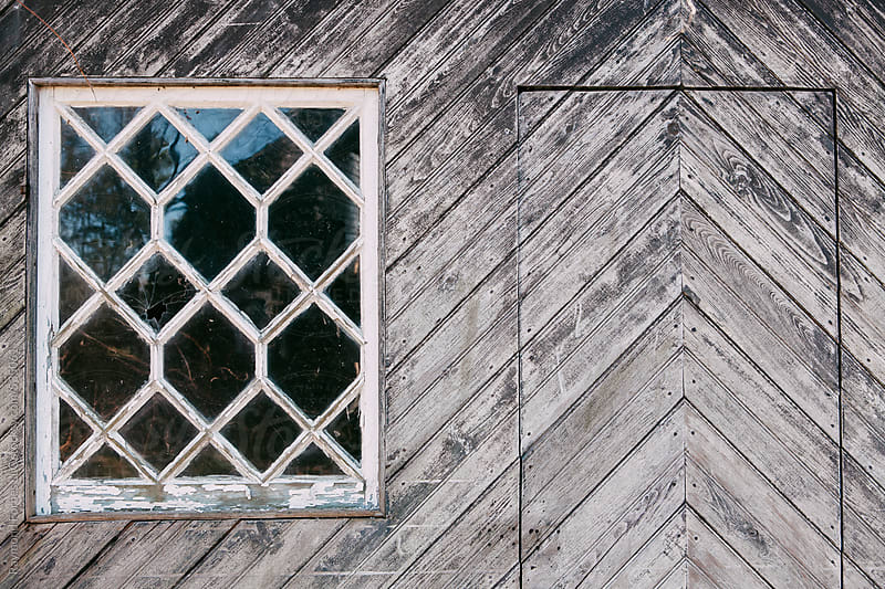 Antique Window in Barn by Raymond Forbes LLC for Stocksy United