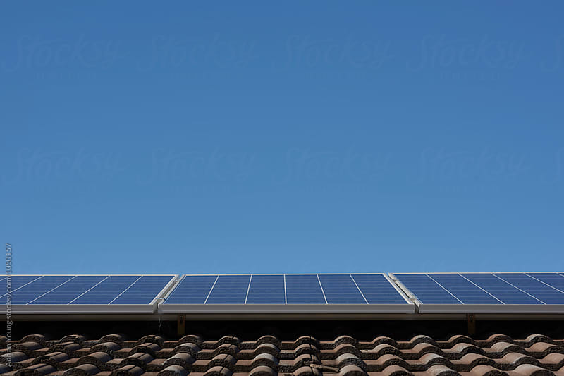 Solar Panels On A House Roof by Adrian Young for Stocksy United