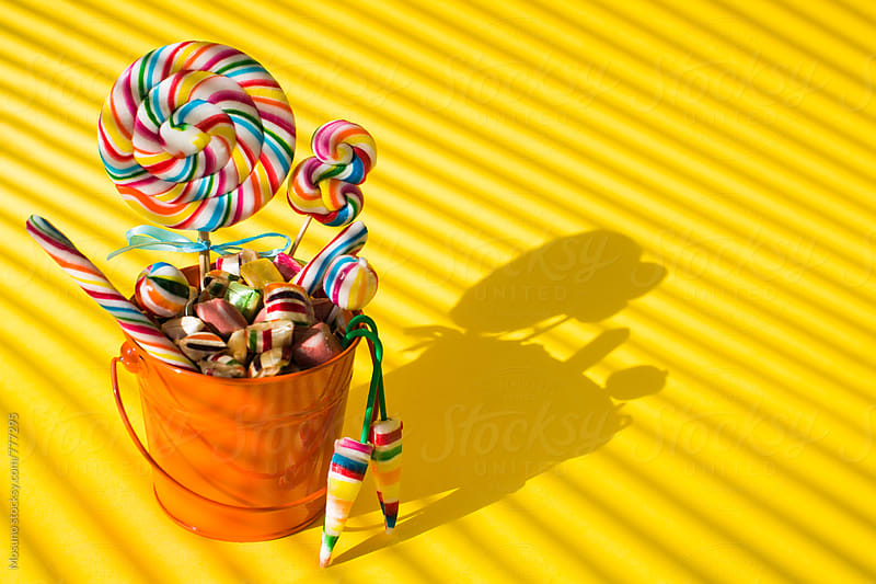 Colourful Candies on a Yellow Background by Mosuno for Stocksy United