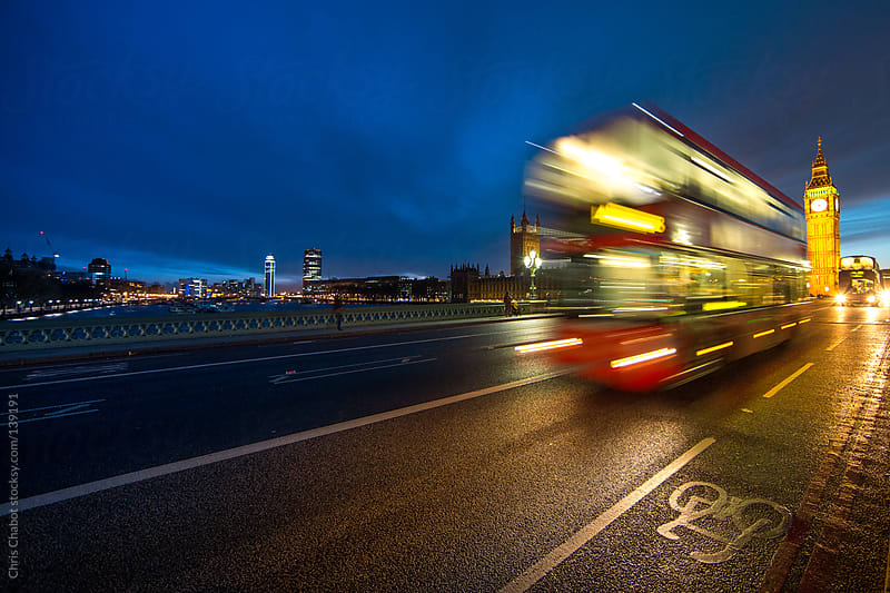 Bus speeding by on Westminster Bridge by Chris Chabot for Stocksy United