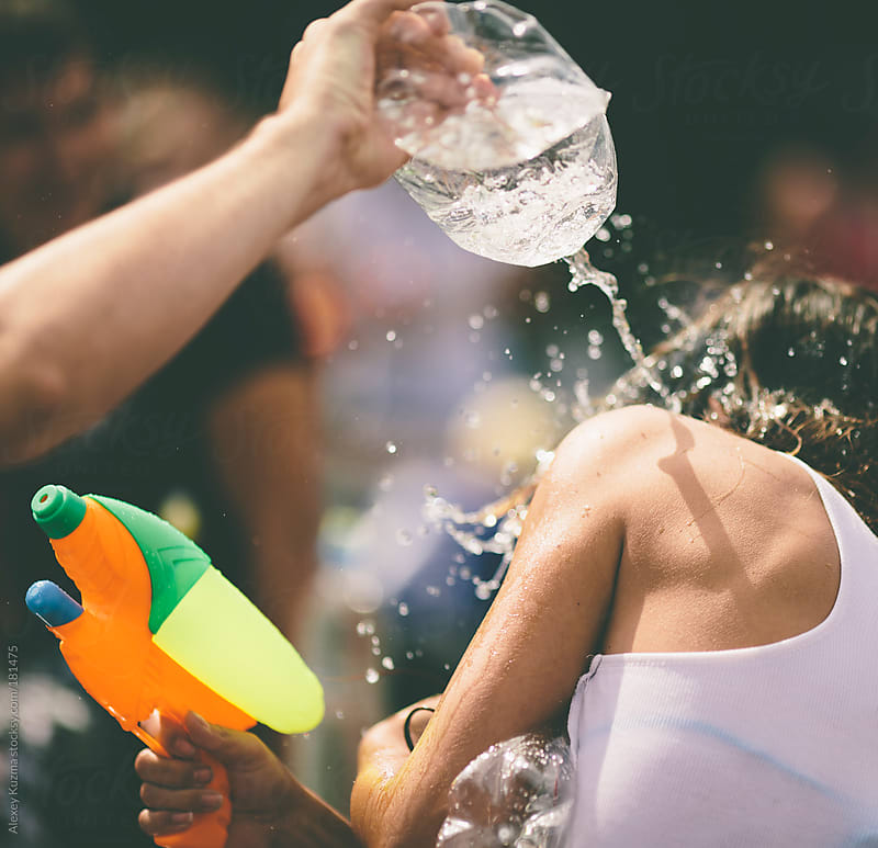 people shooting and throwing water  by Alexey Kuzma for Stocksy United