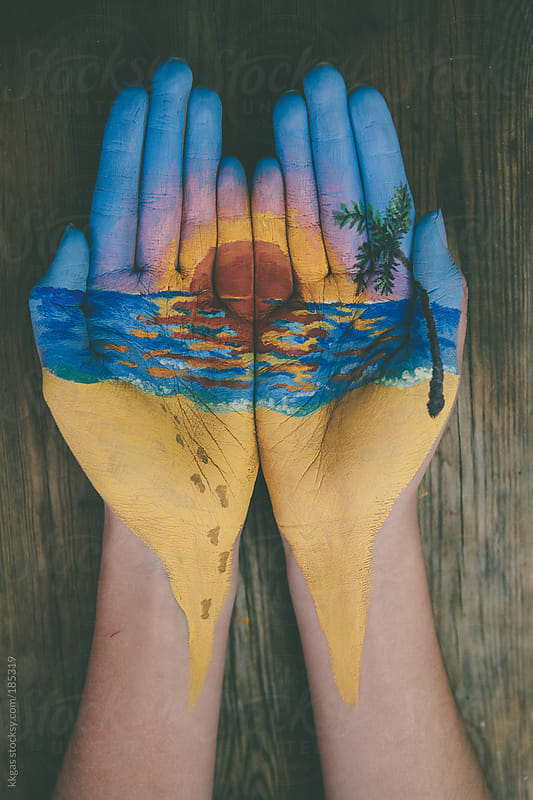 Beach sunset painted on woman's hands by kkgas for Stocksy United
