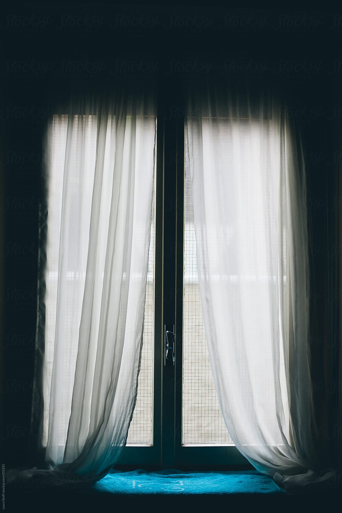 Light Coming Inside Dark Room From Window With Curtains By Laura Stolfi Dark Window Stocksy United