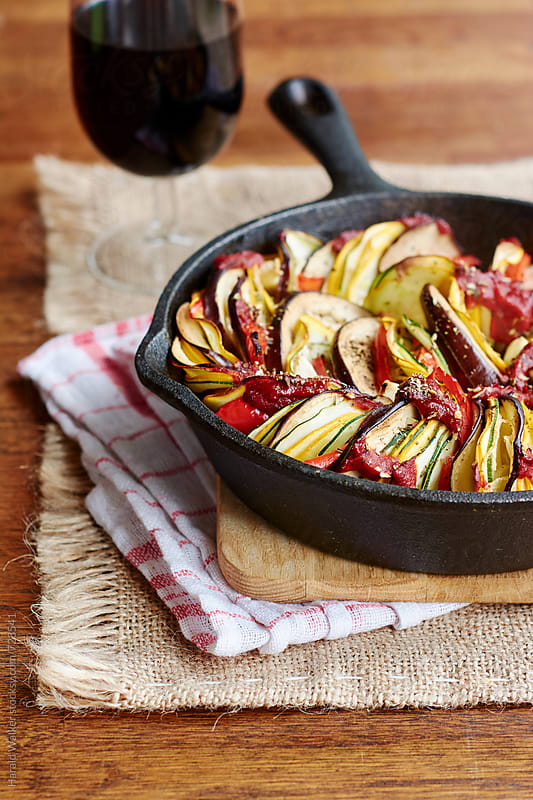 Ratatouille in a cast iron pan by Harald Walker for Stocksy United