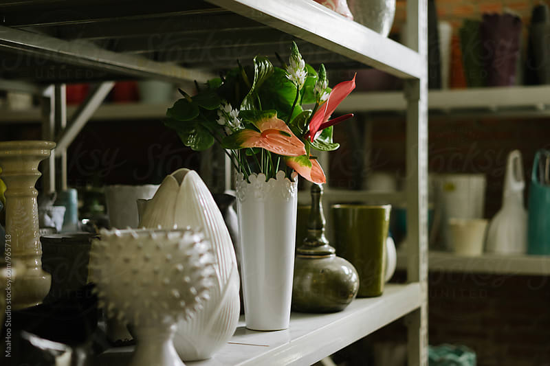 Shelf with empty vases and bouquet of flower by Maa Hoo for Stocksy United