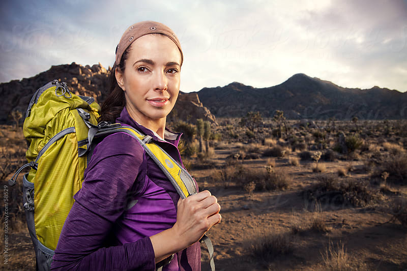Woman hiking in desert by Neil Kremer for Stocksy United