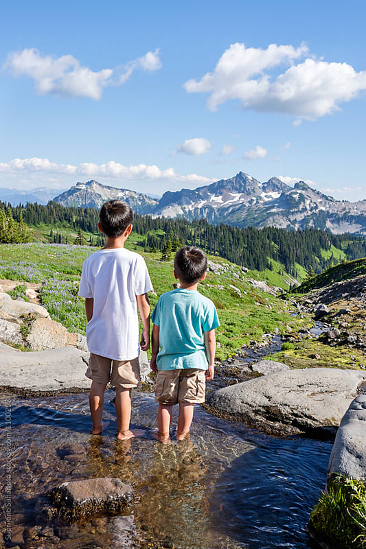 Young boys outdoor enjoying the view of the beautiful mountain s by Suprijono Suharjoto for Stocksy United