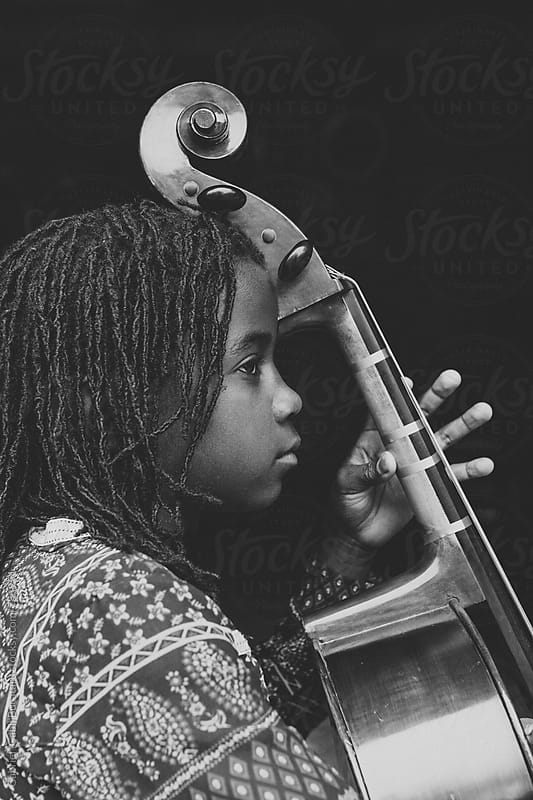 Black girl with cello by Gabriel (Gabi) Bucataru for Stocksy United