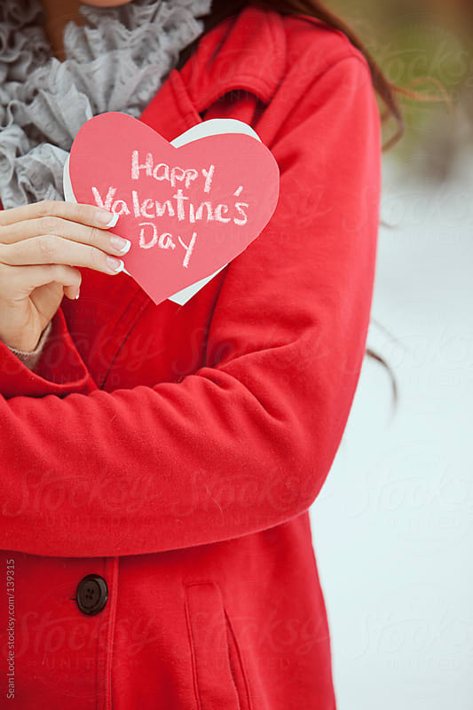 Valentine's: Holding A Holiday Love Note by Sean Locke for Stocksy United