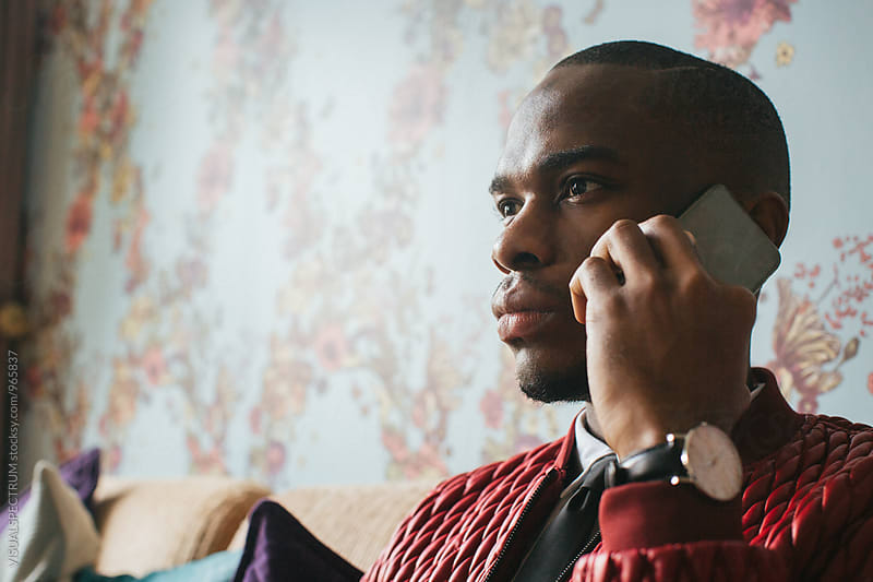 Close Up of Stylish Young Black Man Talking on Cellphone by Julien L. Balmer for Stocksy United
