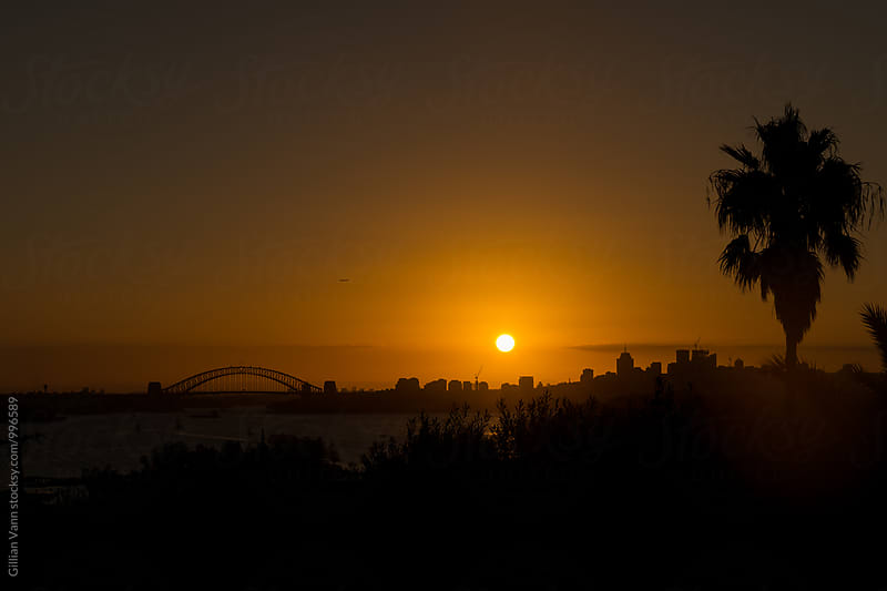 silhouette of Sydney Harbour Bridge at sunset by Gillian Vann for Stocksy United
