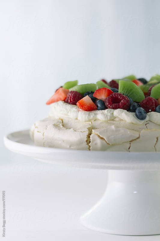 Pavlova vertical with summer fruits by Kirsty Begg for Stocksy United